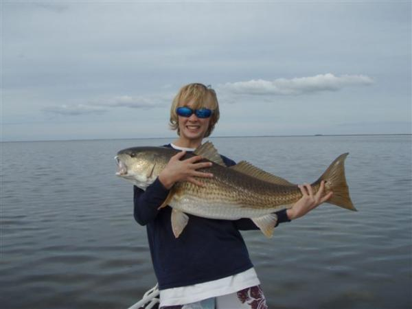 boy with huge redfish