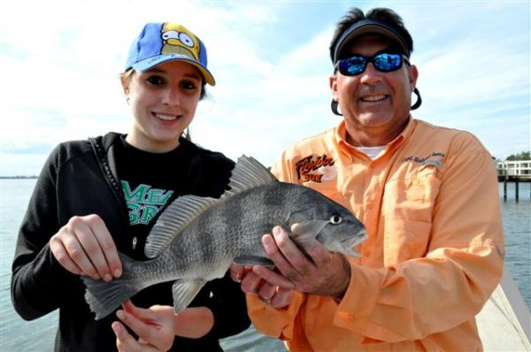 girl and captain with black drum