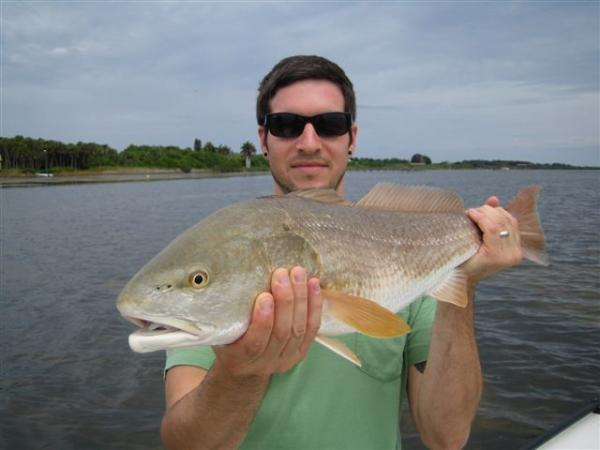 man with redfish