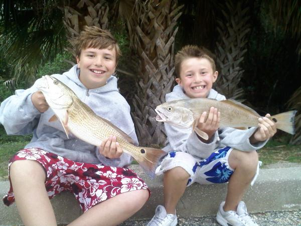 boys with redfish