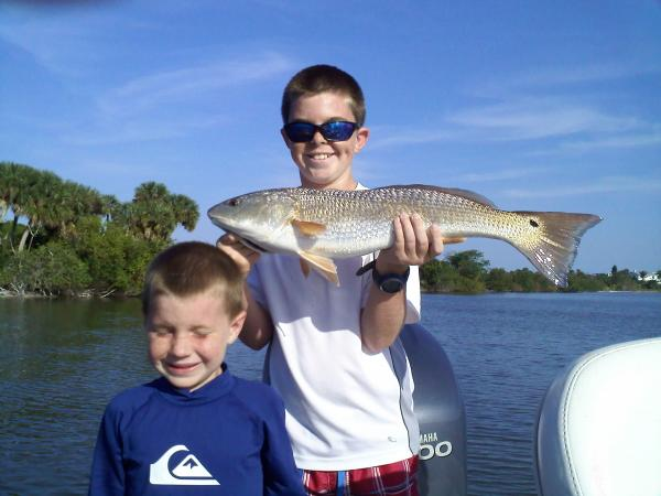 2 boys and redfish
