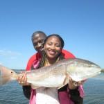 Tawanda holding Jason's Biggest Redfish