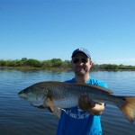 Allan holding his 1st Redfish