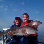 David and Christian with a pair of Redfish